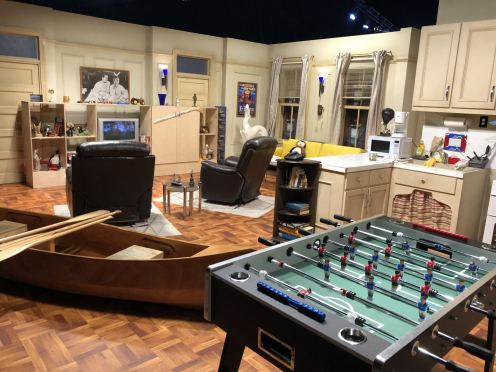 Comedy Central UK's Friends Fest 2018: A wide shot of the whole set of Chandler and Joey's apartment. You can see the fussball table, the canoe and the recliner chairs