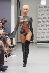 Transgender model & activist Tallullah Eve on the runway for Jayne Pierson SS19 at London Fashion Week wearing a hand painted bodysuit with bell sleeves and a waspie with thigh high boots (Fashion Voyeur blog)