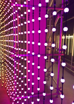 An image taken from the 2018 installation #MulberryLights at 100 Regent Street from fashion brand Mulberry as part of their Christmas campaign featuring some hanging white string lights in a straight line. Fashion Voyeur Blog
