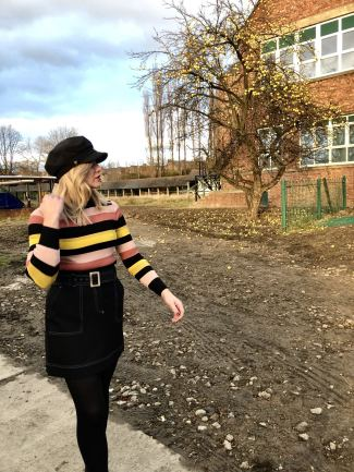Fashion Blogger Pixie Tenenbaum wears an A-Line skirt and striped sweater from the Winter 2018 edit of Holly's Must Haves from Marks & Spencer with a Dior bag & a baker boy hat for Fashion Voyeur