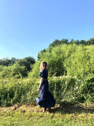 An image of Fashion Blogger Pixie Tenenbaum wearning a vintage prairie dress in the style of Gunne Sax and Batsheva on the riverbank in Durham