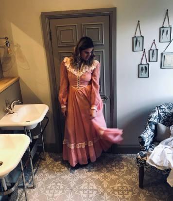 Blogger Pixie Tenenbaum wearing a dusky pink Gunne Sax dress at Beadnell Towers Hotel