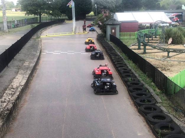 The kids Racetrack at Wicksteed Park. Real mini petrol cars on a small race track which circles the thrill zone of the theme park