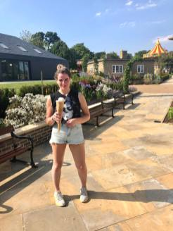Pixie Tenenbaum holding a colossal ice cream the size of an Olympic torch at Wicksteed Park in Kettering on the hottest day of the year in 2019