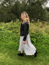 Blogger Pixie Tenenbaum wears the Zara Hot 4 The Spot polka dot dress on Conde Nast's Wear The dress Day (August 22nd 2019) with a black Zara leather biker jacket on Durham's River Walk