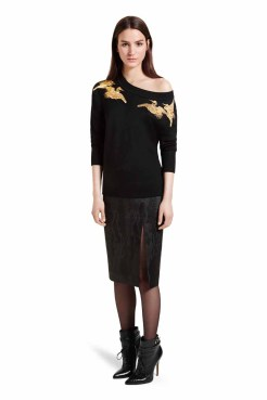 Go for a look of nonchalant elegance by pairing this slouchy sweater with the classic polish of a pencil skirt. Ankle boots give this look an edge of tough and sexy glamour. LOOK 5 Sweater with Crane Embroidery, $49.99** Pencil Skirt in Black Jacquard, $34.99** Ankle Boot in Black, $59.99 ** AVAILABLE GLOBALLY ON NET-A-PORTER.COM