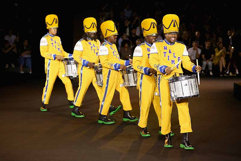 NEW YORK, NY - OCTOBER 19: A drumline walks the runway at the KENZO x H&M Launch Event Directed By Jean-Paul Goude' at Pier 36 on October 19, 2016 in New York City. (Photo by Thomas Concordia/Getty Images for H&M)