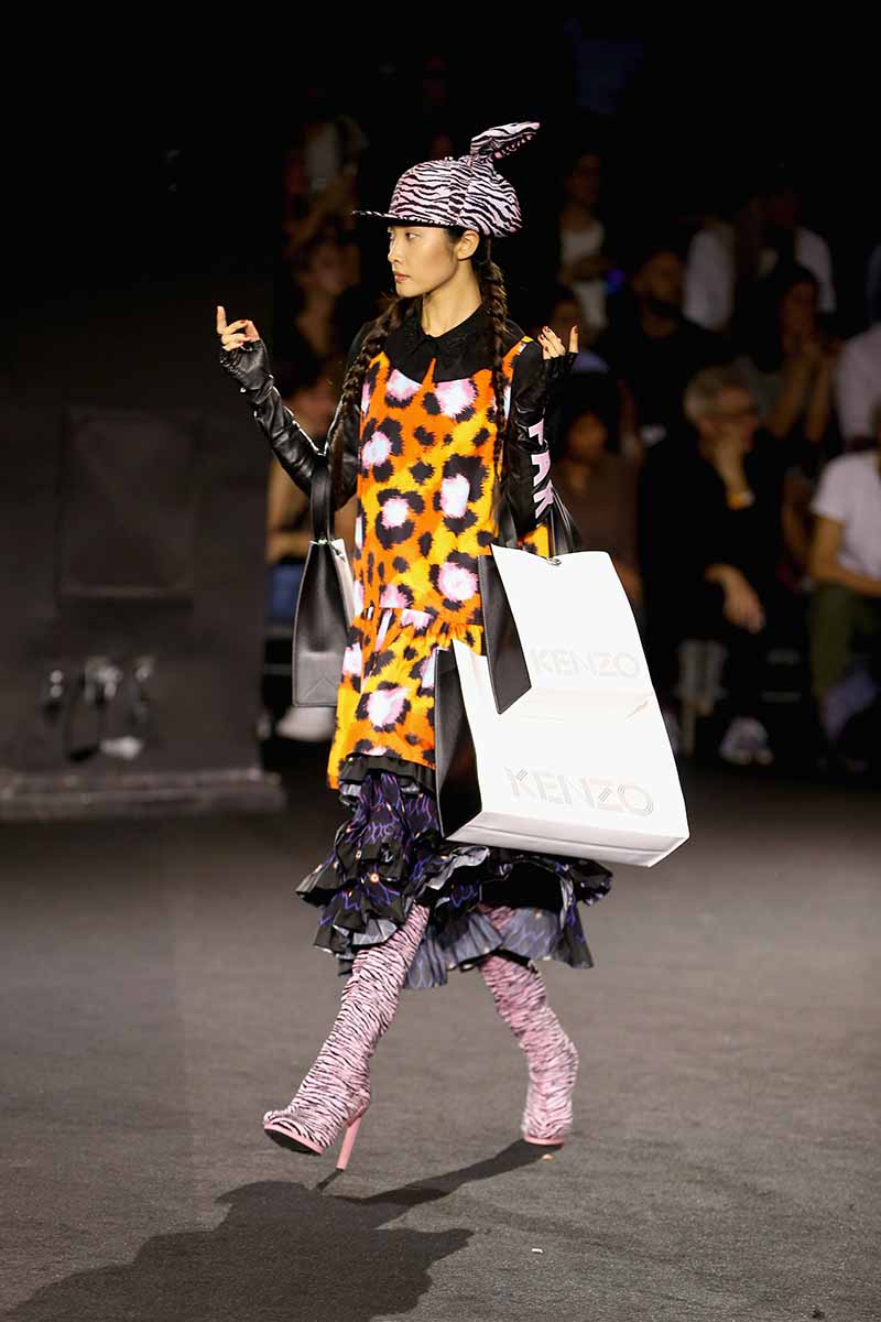 NEW YORK, NY - OCTOBER 19: A model walks the runway at the KENZO x H&M Launch Event Directed By Jean-Paul Goude' at Pier 36 on October 19, 2016 in New York City. (Photo by Thomas Concordia/Getty Images for H&M)