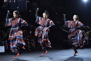 NEW YORK, NY - OCTOBER 19: Models walk the runway at the KENZO x H&M Launch Event Directed By Jean-Paul Goude' at Pier 36 on October 19, 2016 in New York City. (Photo by Dimitrios Kambouris/Getty Images for H&M)