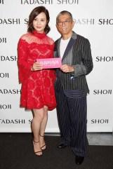 NEW YORK, NY - SEPTEMBER 07: Actresses Tao Hong and designer Tadashi Shoji pose backstage before the Tadashi Shoji fashion show at Gallery 1, Skylight Clarkson Sq on September 7, 2017 in New York City. (Photo by Thos Robinson/Getty Images For Tadashi Shoji)