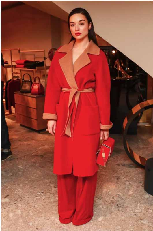 Crystal Reed in Max Mara red and camel coat and red trousers.