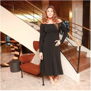Maria Giulia Maramotti in a Max Mara black off-the-shoulder dress.