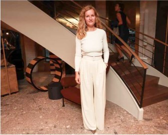 Marlies Verhoeven In Max Mara cream top, cream trousers and white belt.