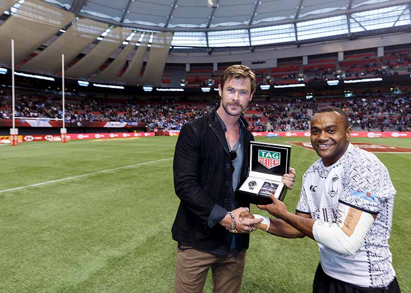 VANCOUVER, BC - MARCH 11: (L-R) TAG Heuer Ambassador Chris Hemsworth presents Tag Heuer watch to Alasio Sovita Naduva of Fiji for the #DontCrackUnderPressure moment of the match at the 2018 Canada Sevens Rugby Tournament at BC Place on March 11, 2018 in Vancouver, Canada. (Photo by Andrew Chin/Getty Images for TAG Heuer)