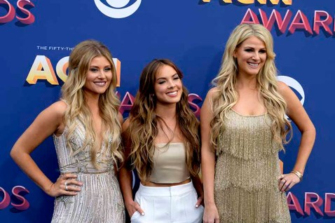The 53rd Academy of Country Music Awards red carpet is held at the MGM Grand Garden Arena on the Las Vegas Strip. Here nominees for New Vocal Group of the Year (l-r) Hannah Mulholland, Naomi Cooke and Jennifer Wayne of Runaway June walk the ACM red carpet. Sunday, April 15, 2018. CREDIT: Glenn Pinkerton/Las Vegas News Bureau