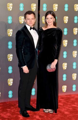Taron Egerton (L) and Emily Thomas