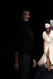 Designer Heni on the runway