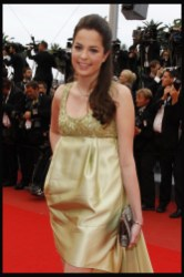 Anouchka Delon is wearing Elie Saab dress accessorized with Montblanc jewelry and Swarovski bag