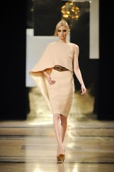 Asymmetrical sand-coloured grain de poudre cape dress.