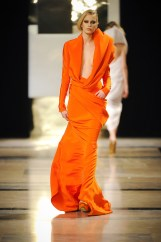Tangerine crpe drap draped long dress.