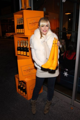 Tinsley Mortimer showing DKNY for Veuve Clicquot boots