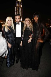 Donatella Versace, Riccardo Tisci, Franca Sozzani, Naomi Campbell at the gala dinner at the Armani Pavilion during Vogue Fashion Dubai Experience on October 10, 2013 in Dubai, United Arab Emirates.