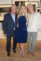Lottie Moss (C) poses with parents Peter Moss (L) and Inga Moss