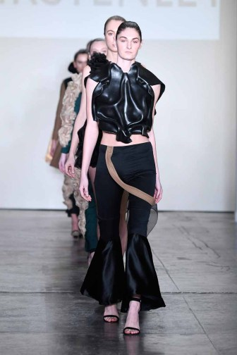 NEW YORK, NY - FEBRUARY 08: A model walks the runway for Global Fashion Collective Presents KIRSTEN LEY At New York Fashion Week Fall 2018 at Industria Studios on February 8, 2018 in New York City. (Photo by Arun Nevader/Getty Images for Global Fashion Collective)