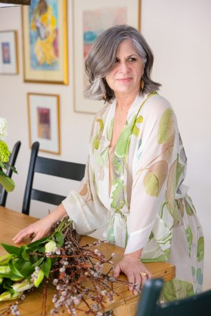Designer Rory Worby wearing one of her original hand painted robes. Photo by Julia D'Agostino.