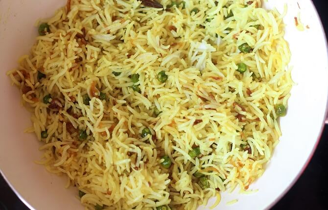 mixed peas pulao recipe in a white pan