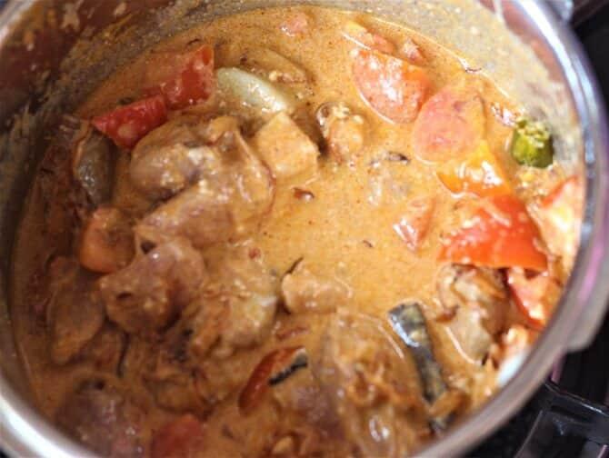 mutton korma recipe being prepared in cooker