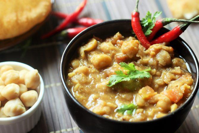 easy chana masala recipe served in a black bowl