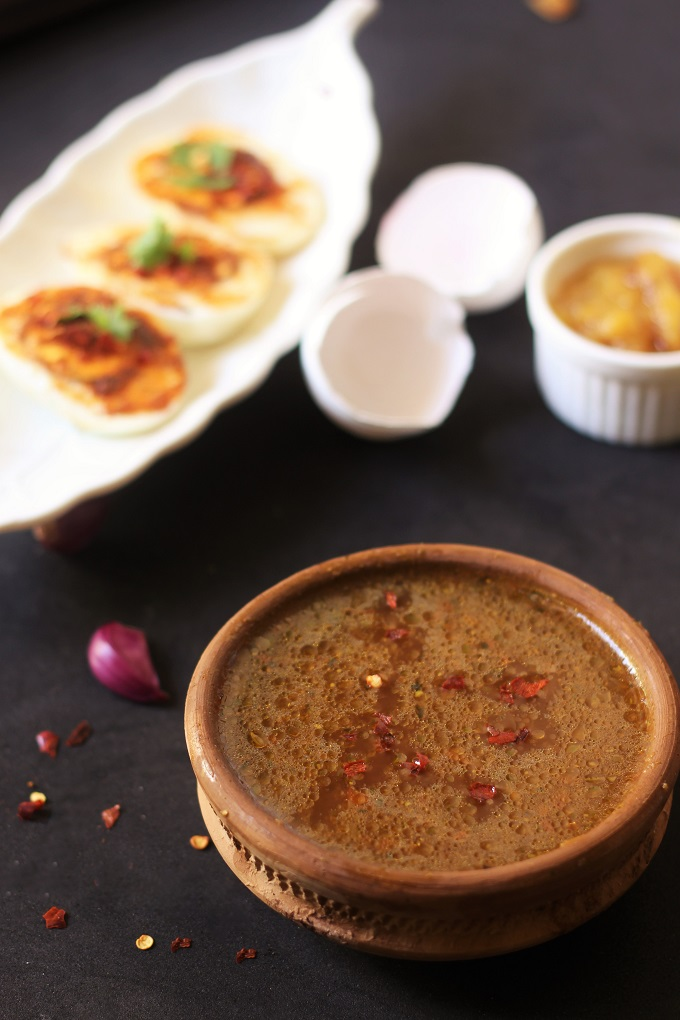 Pepper Rasam Recipe Andhra Style served in a clay bowl
