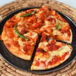 Chicken Tikka Pizza Recipe-If you love Chicken Tikka, you'll love it as a topping on Chicken Tikka Pizza Recipe. This is totally your kind of pizza if you like the Indian cuisine in everything that you eat. #chickentikkapizza #chickenpizza #tikkapizza #chickentikka #pizzarecipe