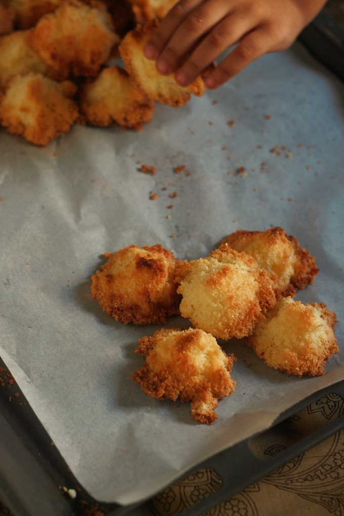 picking an easy coconut macaroon from the baking tray