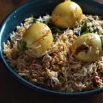 hyderabadi egg biryani recipe served in a blue bowl