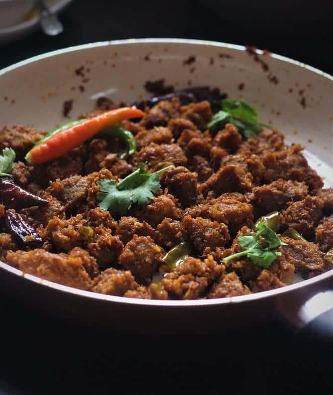 close up view of achari gosht masala
