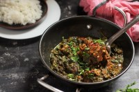 side view of the palak gosht recipe in a kadai
