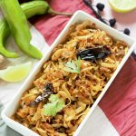 cabbage poriyal recipe in rectangular bowl
