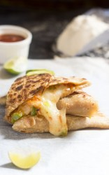 Bored of eating the same types of parathas again and again? Want to try something fun and different from your regular parathas? How about Pizza Paratha recipe? Yes, you heard that right!! Pizza Paratha!!!