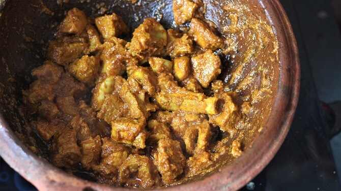 frying andhra mutton fry in clay kadai