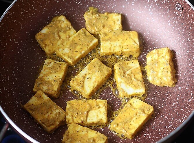 frying paneer in a pink pan