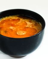 chettinad-thakkali-kulambu in a black bowl