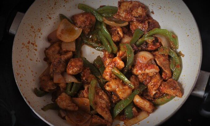 chicken jalfrezi recipe in a white pan