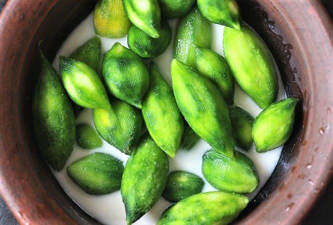 bitter gourds in buttermilk in a clay pot
