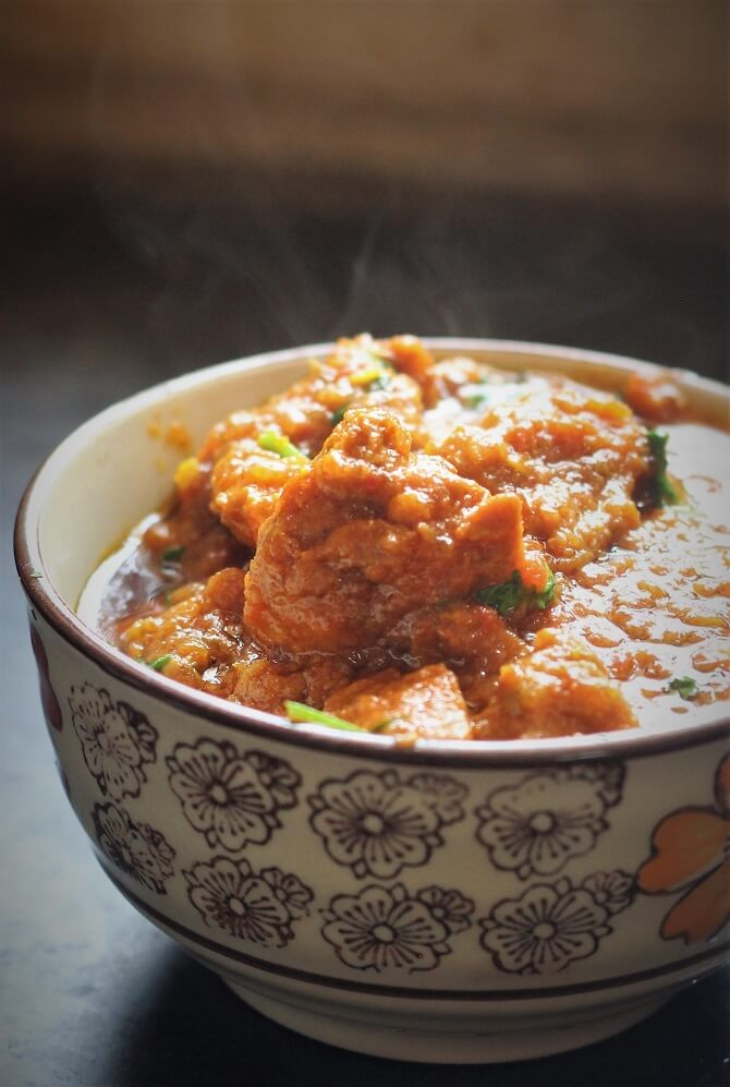 side view of mutton handi recipe in a bowl