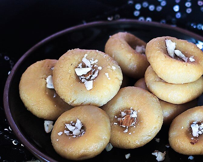 doodh peda recipe topped with badam in a plate