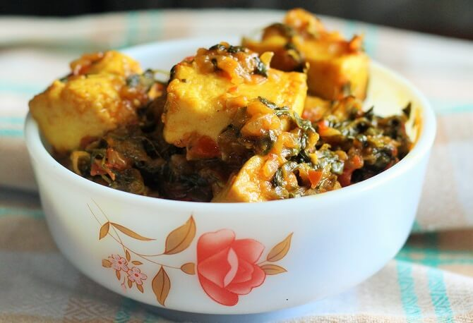 side view of methi paneer recipe in a bowl.