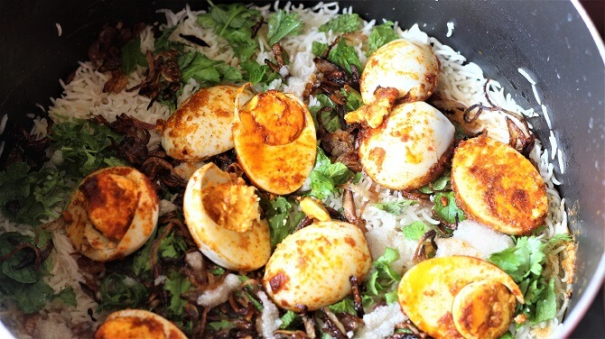 egg dum biryani being prepared with final touches