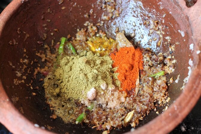 whole spices and green chilli in onion